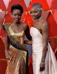 Lupita Nyong'o and Danai Gurira arrive for the 90th annual Academy Awards in Hollywood