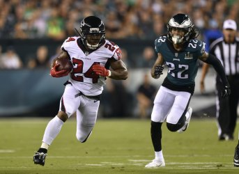Falcons' Devonta Freeman runs the ball