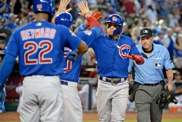 Cubs' Baez celebrates three run home run