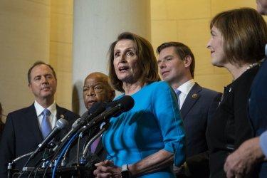 House Democratic Leader Nancy Pelosi speaks with reporters