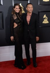 Chrissy Tiegen and John Legend arrive for the 59th annual Grammy Awards in Los Angeles