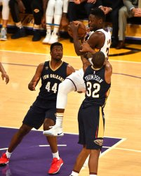 Los Angeles Lakers Julius Randle is fouled by Pelicans guard Hollis Thompson (32)