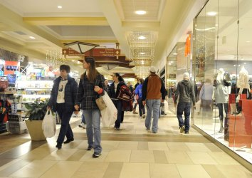 Shoppers walk through mall in Brookfield, Wisconsin