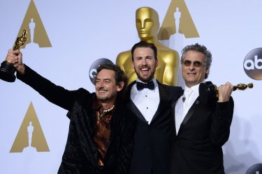 Chris Evans, David White and Mark Mangini, holding their award, backstage at the 88th Academy Awards in Hollywood