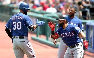 Rangers Mazara celebrates with Odor after homerun against Indians