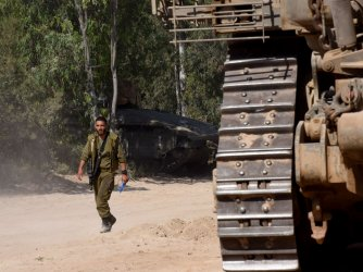 An Israeli Soldier Walks In A Staging Area On The Israel-Gaza Border