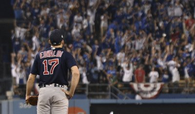 Red Sox pitcher Eovaldi watches Dodgers Muncy's game winning home run during the eightheenth inning in Game 3 of the World Series
