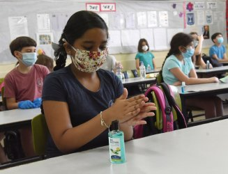 Israeli Children Wear Protective Mask as They Return to School