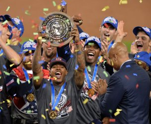 Team USA's Marcus Stroman hoists the MVP trophy after 8-0 win over Puerto Rico in Los Angeles
