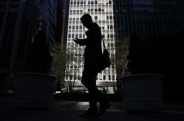 A man walks down Park Avenue in New York City