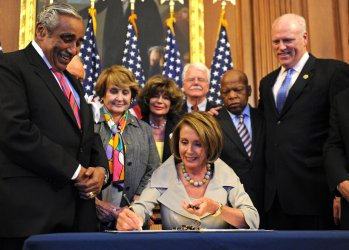 Pelosi signs unemployment extension legislation in Washington