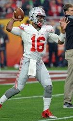 Ohio State quarterback J. T, Barrett throws a pass to warm up