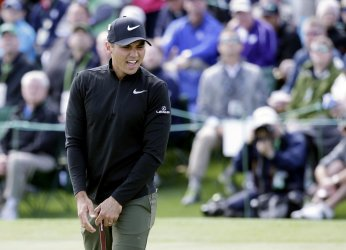 Jason Day of Australia reacts after missing a putt at the Masters