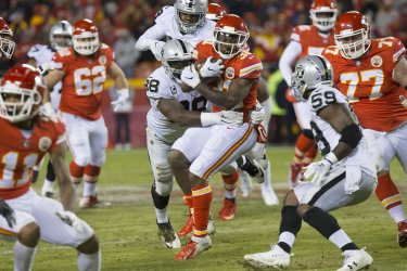 Chiefs Darrel Williams is taken down by Oakland Raiders Marcell Ateman