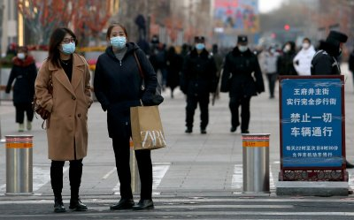 Chinese Wear Masks in Shopping Area in Beijing, China