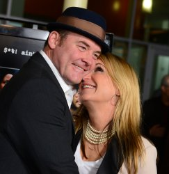 "David Koechner and his wife Leigh attend the premiere of ""A Haunted House"" in Los Angeles"