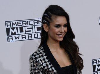 Nina Dobrev attends the 2016 American Music Awards in Los Angeles
