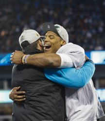 Carolina Panthers quarterback Cam Newton and coach Ron Rivera celebrate winning NFC Championship