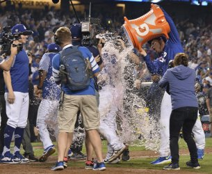 Dodgers Muncy doused with Gatorade after hitting game-winner solo home run during the eighteenth inning in Game 3 of the World Series