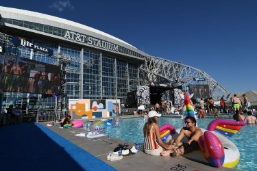 Guests enjoy the pool constructed outside AT&T Stadium for KAABOO