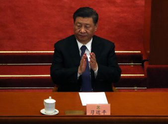 Xi Claps During The CPPCC Closing Session in Beijing, China