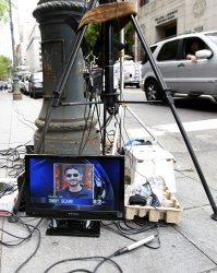 A picture of Pakistani-born U.S. citizen Faisal Shahzad shows up on a TV in New York