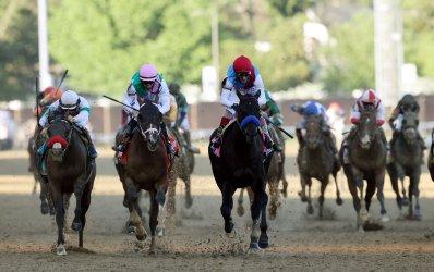 Jockey John Velazquez with Medina Spirit Wins the 147th Running of the Kentucky Derby