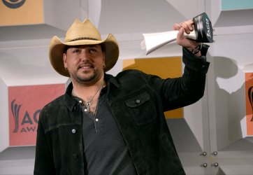 Jason Aldean wins an award backstage at the 51st  annual Academy of Country Music Awards in Las Vegas