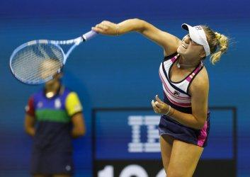 Sofia Kenin serves at the US Open
