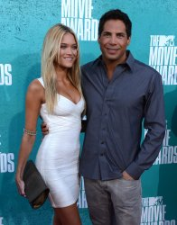 Joe Francis (R) and guest arrive at the 2012 MTV Movie Awards in Universal City, California