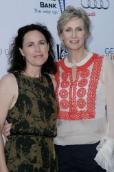 Jane Lynch and Lara Embrey attend Backstage at the Geffen fundraiser in Los Angeles