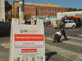 A Sign Warns Residents of High-Risk COVID-19 Area in L.A.