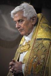 Pope Benedict XVI prays during a Corpus Domini procession in Rome