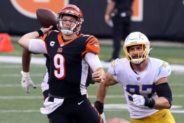 Bengals Joe Burrow Throws under Pressure from Chargers Joey Bosa
