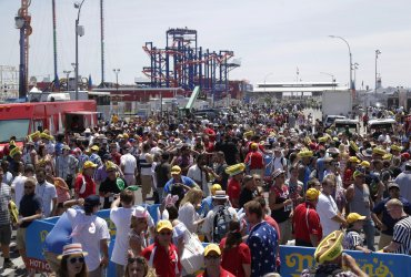 Crowds of people gather around the beach