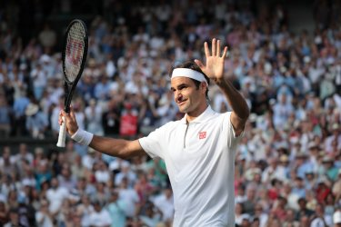 Roger Federer celebrates his win in his Quarter-Final match against Kei Nishikori