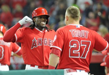 Los Angeles Angels' Cameron Maybin is congratulated by teammates after hitting a homerun against the Mariners in Anaheim