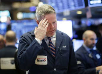 Dow tumbles 1,000 points for third time in one week