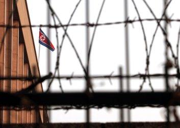 The North Korean national flag flies over its embassy in Beijing