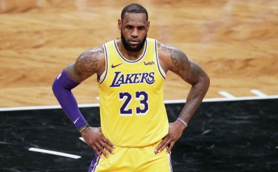 Los Angeles Lakers LeBron James stands on the court