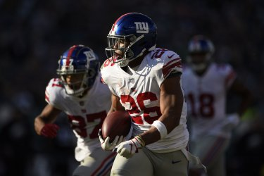 Giants' Saquon Barkley runs the ball for a touchdown