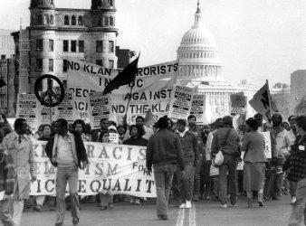 A small anti-Klan rally makes its way down Pennsylvania Avenue in Washington DC.