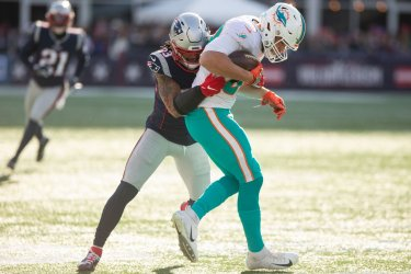 Dolphins Gesicki tackled by Patriots Chung