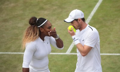 Andy Murray and Serena Williams discuss tactics in their third round Mixed Doubles match