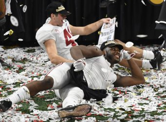 Alabama players celebrate in confetti after 26-23 National Championship win