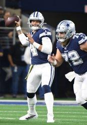 Dallas Cowboys quarterback Dak Prescott (4) throws against the Minnesota Vikings