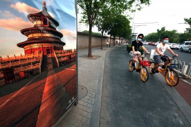 Chinese wearing protective face masks bicycle in Beijing, China
