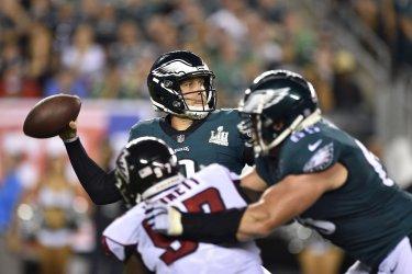 Eagles quarterback Nick Foles throws the ball