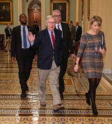 U.S. Sen. Majority Leader Mitch McConnell walks to his office On Capitol Hill