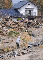 Clean-up continues one month after massive earthquake and tsunami struck Japan